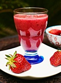 A pomegranate and strawberry smoothie