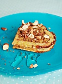 A heart-shaped waffle with hazelnuts, honey and chocolate