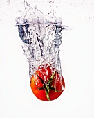 A tomato falling into water