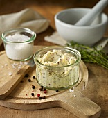Butter flavoured with pepper, salt and thyme