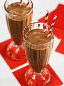 Chocolate milk shake in two glasses with drinking straws