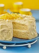 Lemon layer cake, one slice removed