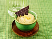 Houmous with a black tortilla chip