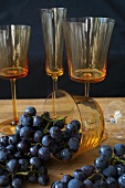 Fresh Purple Grapes with Assorted Wine Glasses