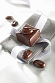 A mocha chocolate on a napkin with a ribbon