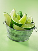 Lime wedges in a metal container