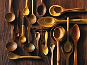 Assorted wooden spoons on a wooden surface