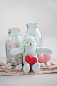 Heart-shaped strawberry and rose macaroons with marshmallows and a stuffed bear
