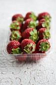 Fresh strawberries in a plastic punnet