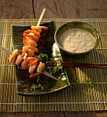 Curry and coconut sauce; served with prawn skewers