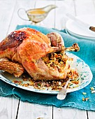 Roast turkey stuffed with almonds, sage and bacon