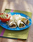 Burritos with salad