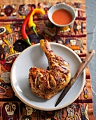 Barbecued chicken leg with spicy chilli sauce