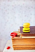 Macaroons on a pile of old books