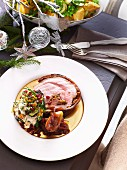 Pork roulade filled with figs served with grilled courgette with a fruity yoghurt sauce