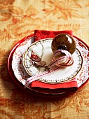 A festive place setting with Christmas decorations