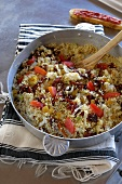 Couscous with olive oil, onions, tomatoes and raisins (Tunisia)