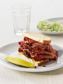 A smoked beef sandwich with gherkins