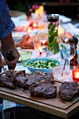 Barbecued beef steaks for a barbecue party in the garden