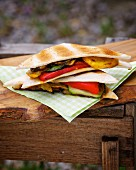 Barbecued tramezzini sandwiches filled with vegetables