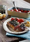 Barbecued beef steak with tapenade and tomatoes
