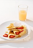 Buttermilk pancakes with strawberries and maple syrup