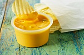 Crisps with cheese dip