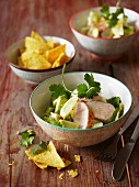 Avocado salad with chicken and coriander, and a bowl of tortilla chips