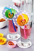 Paper cake cases decorating drinking glasses