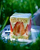 A slice of strawberry and buttermilk layer cake