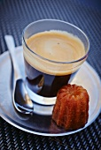 An espresso and a mini cannelé (small cake with vanilla and rum, France)