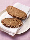Two slices of wholemeal bread on a plate