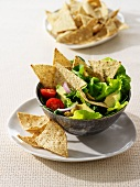 Leaf salad with vegetables and wholemeal tortilla chips