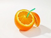 An orange, cut open, with a drinking straw