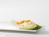 Salmon mousse with caviar on a chicory leaf