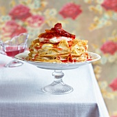 Pancakes with sweetened whipped cream and blood oranges