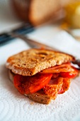A toast sandwich with tomatoes and bacon