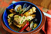 Fish stew with chorizo, clams and mussels