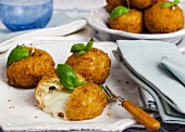 Arancini with cheese filling and basil