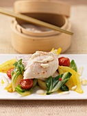 Steamed rose fish on a bed of vegetables (Asia)