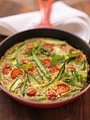Asparagus omelette with cherry tomatoes