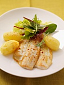Fried plaice with boiled potatoes and salad leaves