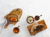 Slices of sourdough bread with assorted spreads