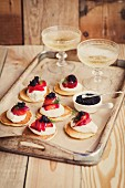 Blinis topped with beetroot, graved lax, crème fraîche and caviar