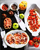 Assorted tomato dishes and fresh tomatoes