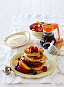 Pancakes with maple syrup and fruits