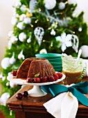 Christmas pudding with caramel and brandy sauce