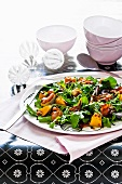 Rocket salad with roasted bacon and squash