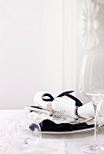 Christmas place setting in white and dark blue