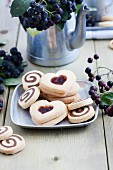Black-and-white biscuits and heart-shaped biscuits with aronia jam